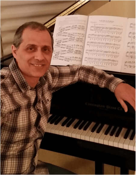 Mark Ingerman with his Cunningham grand piano