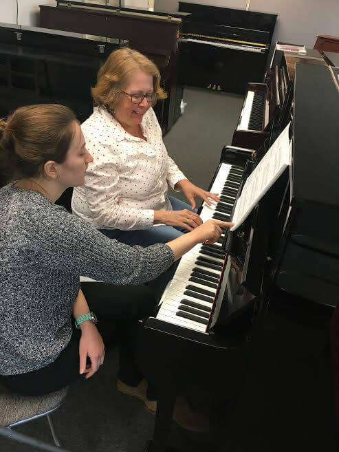 A student learning piano from his teacher at Cunningham Piano Music School
